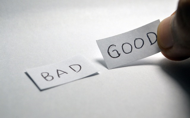 "The words ""Bad"" and ""Good"" on small piece of paper"
