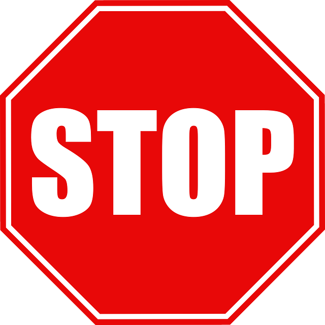 STOP sign: red octagon, white letters and edging